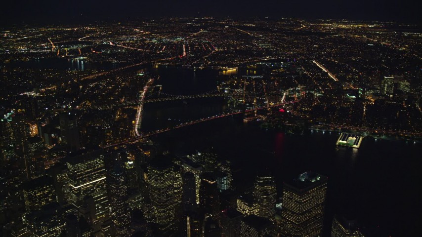 5.5K stock footage aerial video orbit Brooklyn and Manhattan Bridges at Night in New York City Aerial Stock Footage | AX121_184