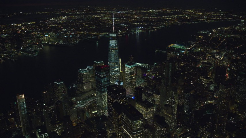 6K stock footage aerial video of World Trade CentersSkyscrapers at Night in New York City Aerial Stock Footage | AX121_187