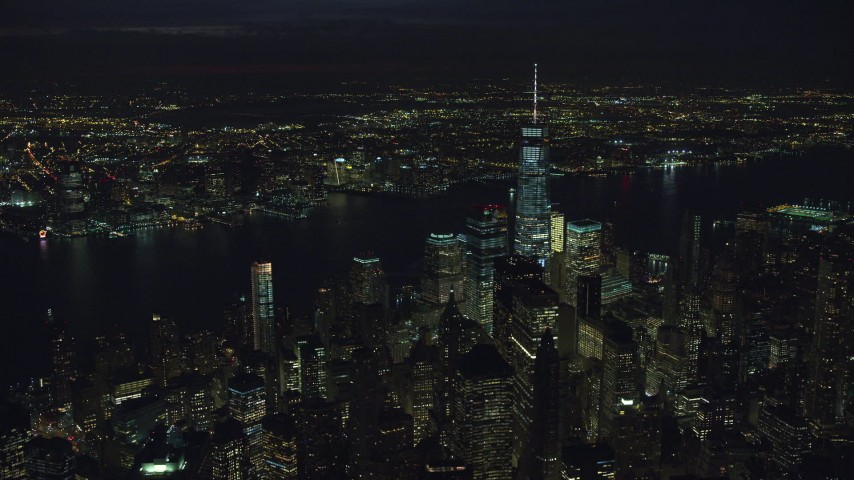 6K stock footage aerial video of a view of World Trade Center skyscrapers at Night in New York City Aerial Stock Footage | AX121_189