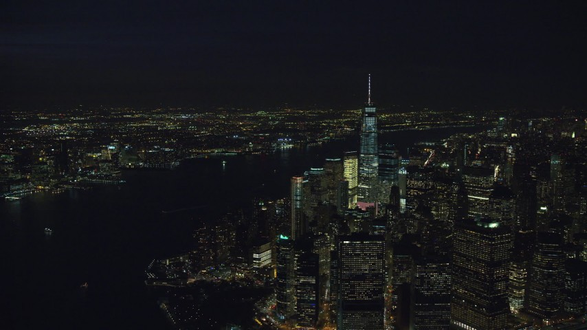 6K stock footage aerial video fly away from Lower Manhattan at Night in New York City Aerial Stock Footage | AX121_191