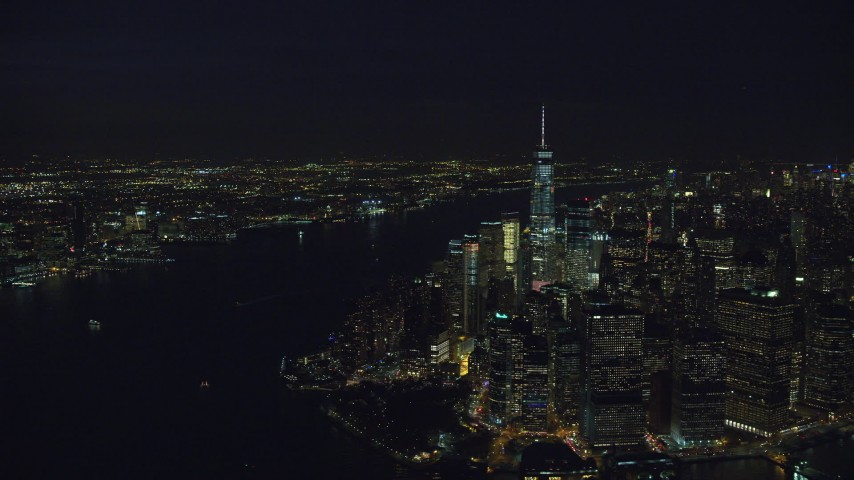 6K stock footage aerial video fly away from Lower Manhattan skyscrapers and Hudson River at Night in New York City Aerial Stock Footage | AX121_192