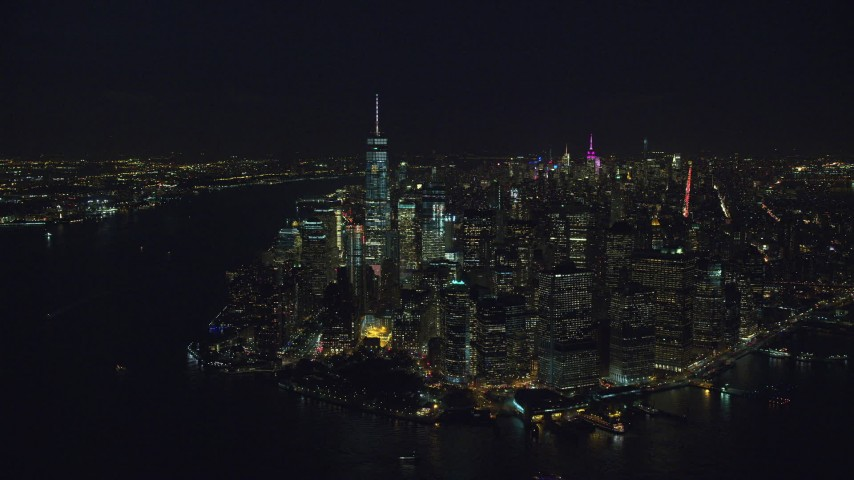 Orbit the Tip of Lower Manhattan at Night in New York City Aerial Stock Footage | AX121_193