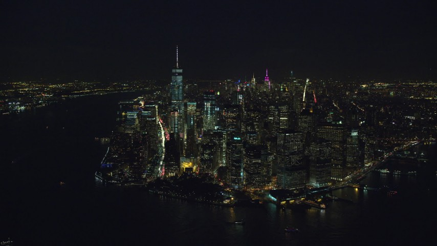 Orbit the Tip of Lower Manhattan at Night in New York City Aerial Stock Footage AX121_193