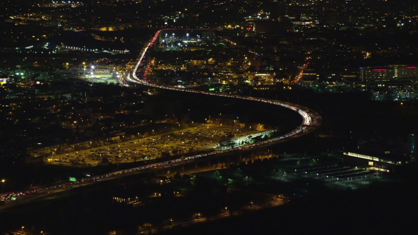 6K aerial video orbit heavy traffic on New Jersey Turnpike at Night Aerial Stock Footage AX121_197