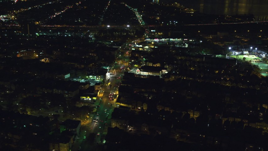 6K stock footage aerial video orbit homes and a busy street near a strip mall at Night, Jersey City, New Jersey Aerial Stock Footage | AX121_201