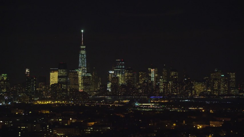 5.5K stock footage aerial video of Lower Manhattan skyscrapers in NYC seen from Jersey City at Night Aerial Stock Footage   AX121_202E