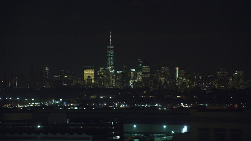 6K stock footage aerial video of Lower Manhattan skyline in NYC seen from Kearny, New Jersey at Night Aerial Stock Footage | AX121_205
