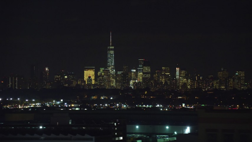 5.5K stock footage aerial video of Lower Manhattan skyline in NYC seen from Kearny, New Jersey at Night Aerial Stock Footage | AX121_205E