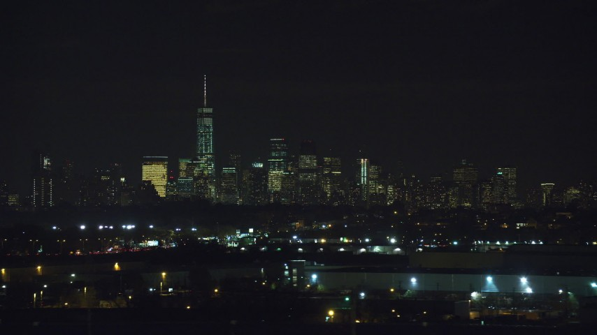 6K stock footage aerial video of the skyline of Lower Manhattan, NYC seen from Kearny, New Jersey at Night Aerial Stock Footage AX121_206
