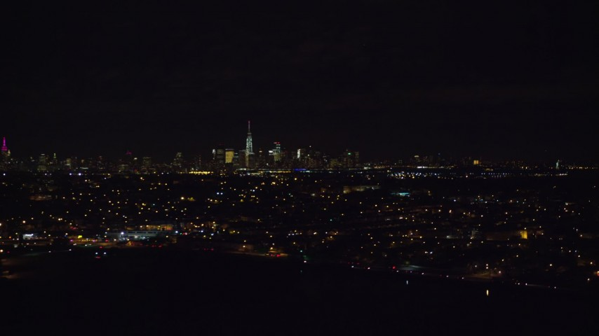 5.5K stock footage aerial video of Lower Manhattan, NYC seen from Jersey City neighborhoods at Night Aerial Stock Footage | AX122_002E