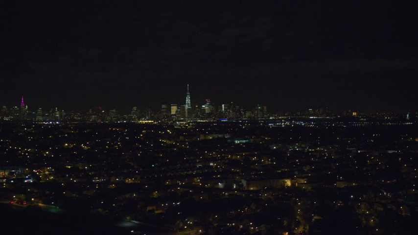 6K stock footage aerial video of a wide view of the skyline of Lower Manhattan, NYC seen from Jersey City at Night Aerial Stock Footage | AX122_003