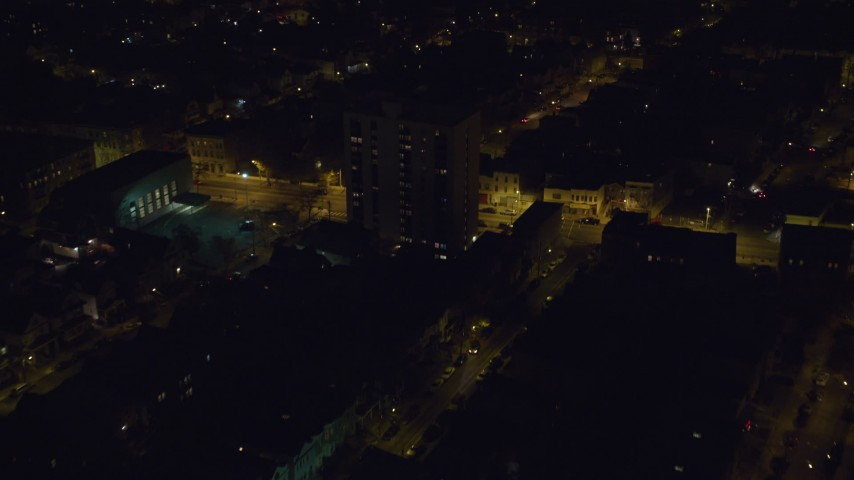 6K stock footage aerial video fly over suburban homes in Jersey City, New Jersey at Night Aerial Stock Footage | AX122_005
