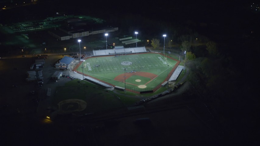 6K stock footage aerial video of approaching a football and baseball stadium at Night in Jersey City, New Jersey Aerial Stock Footage | AX122_007