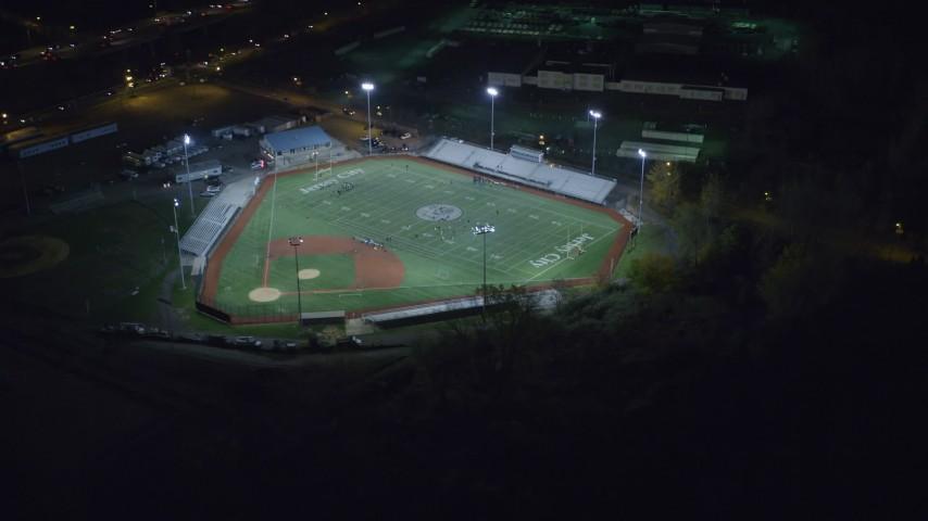 6K stock footage aerial video orbit multi-purpose stadium at Night in Jersey City, New Jersey Aerial Stock Footage | AX122_008
