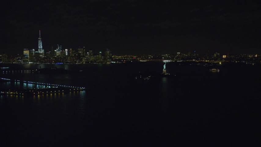 Orbit of Statue of Liberty and Lower Manhattan at Night Aerial Stock Footage   AX122_009