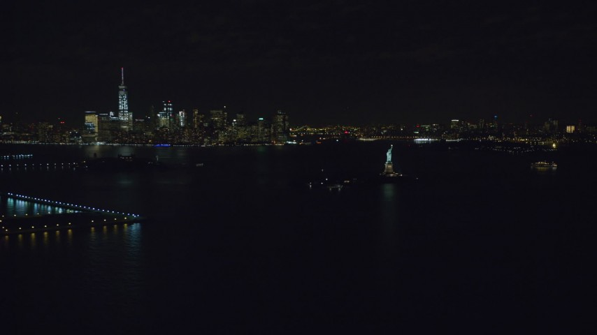 6K stock footage aerial video of a wide orbit of Statue of Liberty and Lower Manhattan at Night, New York Aerial Stock Footage | AX122_009