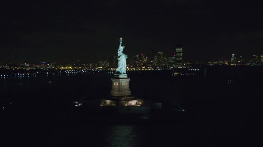 6K stock footage aerial video orbit the front of the Statue of Liberty at Night in New York Aerial Stock Footage   AX122_013