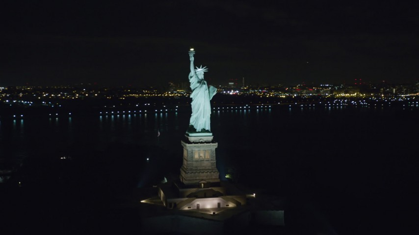 6K stock footage aerial video orbit the Statue of Liberty at Night in New York Aerial Stock Footage | AX122_014