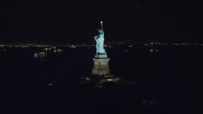 6K stock footage aerial video orbit around the back of the Statue of Liberty at Night in New York Aerial Stock Footage | AX122_017