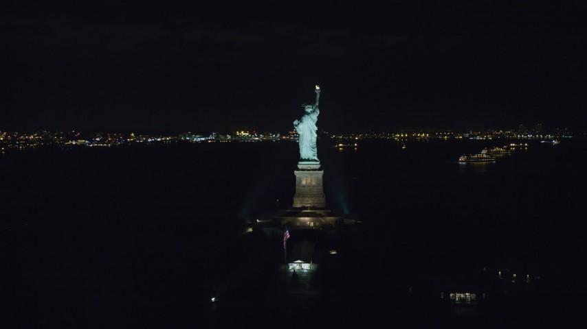 6K stock footage aerial video orbit back of Statue of Liberty at Night in New York Aerial Stock Footage | AX122_018