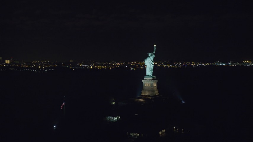 Orbiting the Back of the Statue of Liberty at Night in New York Aerial Stock Footage | AX122_019