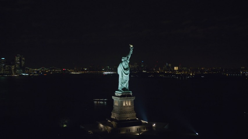 Orbit the Side of the Statue of Liberty at Night in New York Aerial Stock Footage | AX122_020