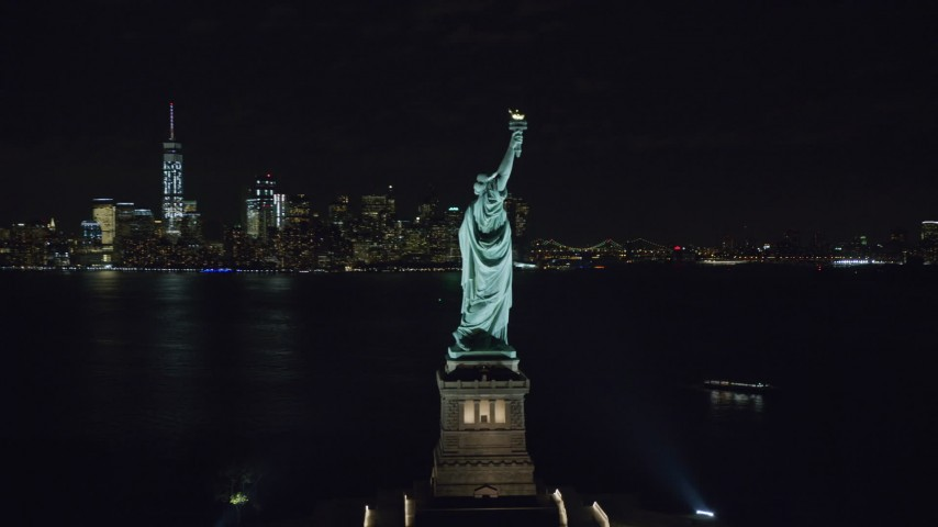 6K stock footage aerial video orbit torch side of the Statue of Liberty at Night in New York Aerial Stock Footage | AX122_021