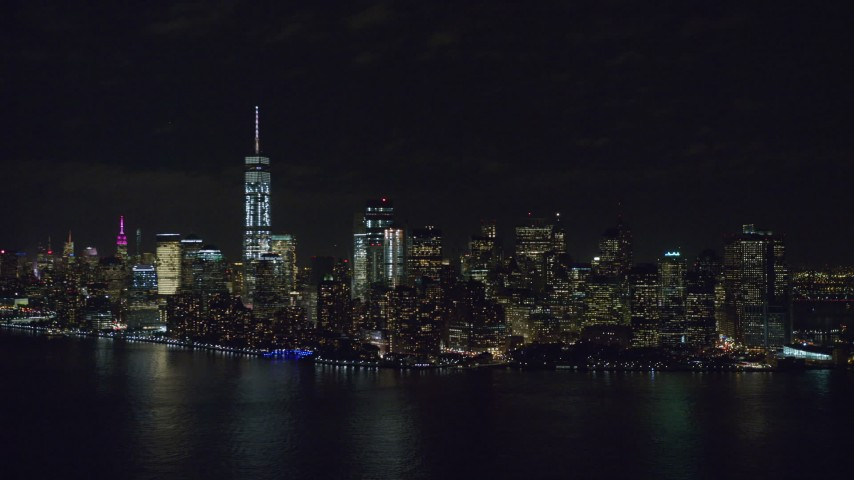 6K aerial video of approaching Lower Manhattan at Night in New York City Aerial Stock Footage | AX122_026