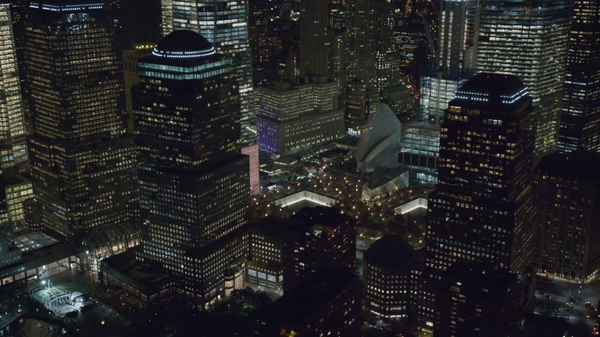 Reveal World Trade Center Memorial at Night in Lower Manhattan Aerial Stock Footage | AX122_031
