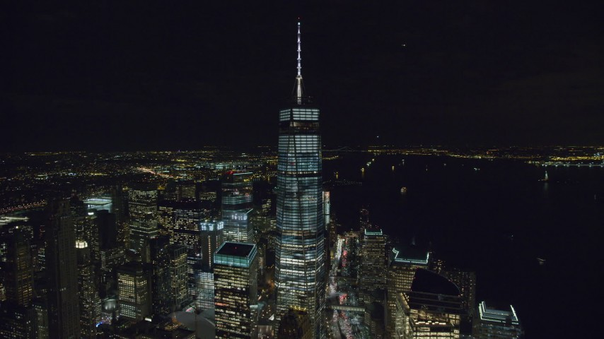 6K stock footage aerial video of an orbit of One World Trade Center at Night in Lower Manhattan, NYC Aerial Stock Footage | AX122_035
