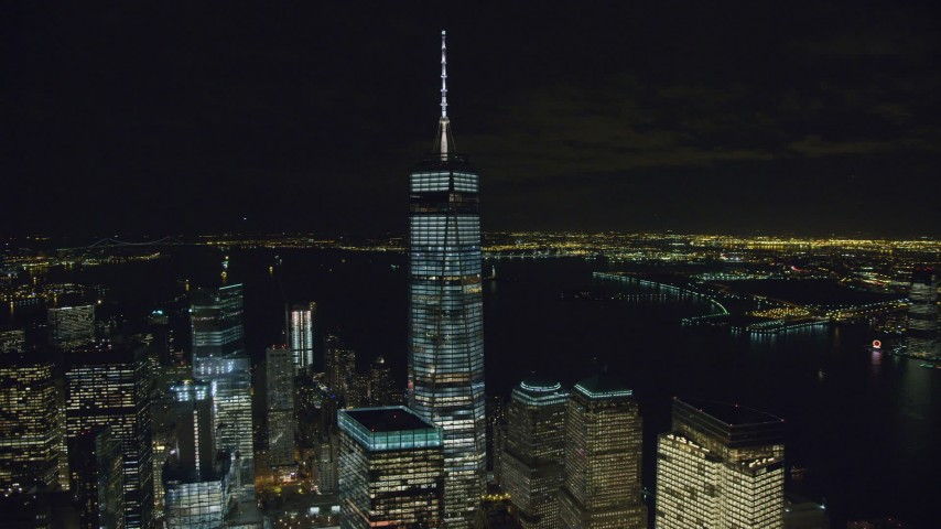 6K stock footage aerial video of an orbit around One World Trade Center at Night in Lower Manhattan, NYC Aerial Stock Footage | AX122_036