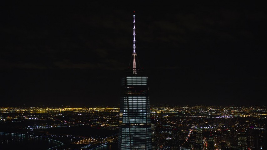 5.5K stock footage aerial video orbit spire of One World Trade Center at Night in Lower Manhattan, NYC Aerial Stock Footage | AX122_038