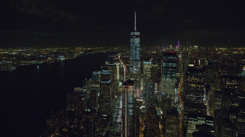 6K stock footage aerial video of Freedom Tower and World Trade Center skyscrapers, Lower Manhattan at Night in NYC Aerial Stock Footage | AX122_044