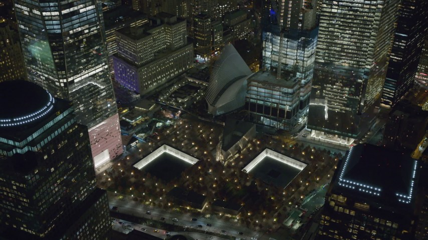 6K stock footage aerial video of World Trade Center Memorial at Night in Lower Manhattan, New York City Aerial Stock Footage | AX122_046