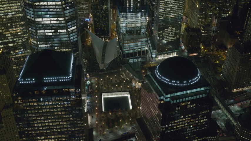 6K stock footage aerial video of the World Trade Center Memorial and Freedom Tower at Night, Lower Manhattan, NYC Aerial Stock Footage | AX122_047