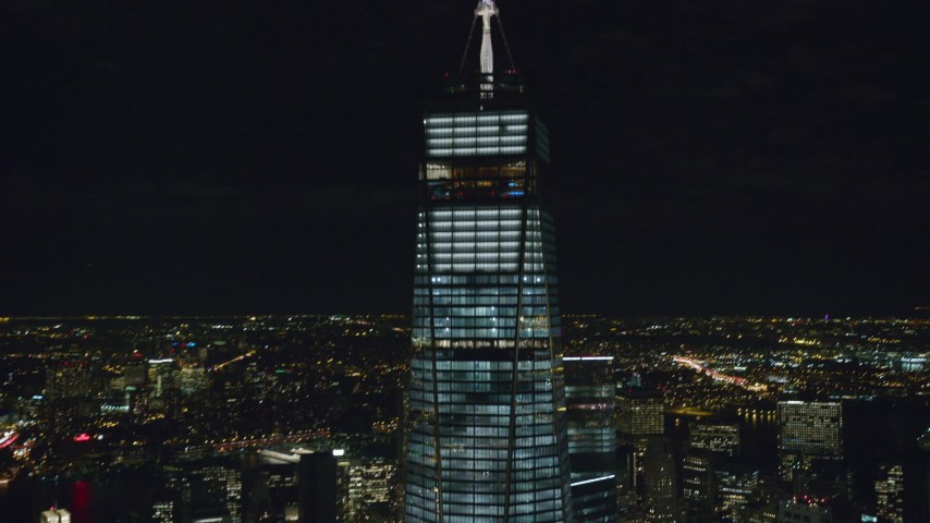 6K stock footage aerial video orbit and tilt up One World Trade Center at Night in Lower Manhattan, New York City Aerial Stock Footage | AX122_048