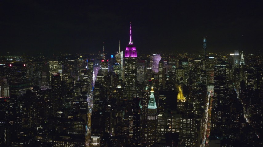 6K stock footage aerial video of a wide orbit of the Empire State Building at Night in Midtown Manhattan, NYC Aerial Stock Footage | AX122_052