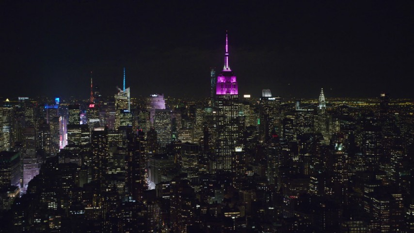 6K stock footage aerial video of circling the Empire State Building at Night in Midtown Manhattan, NYC Aerial Stock Footage | AX122_054