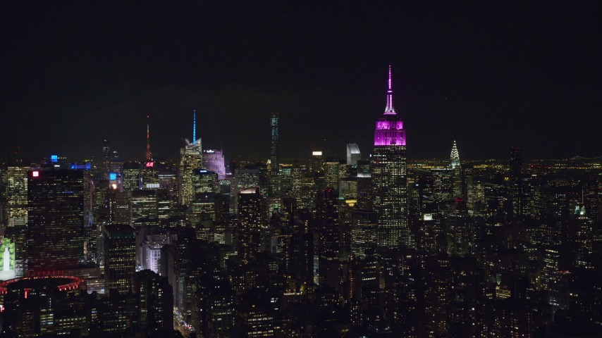 6K stock footage aerial video of Empire State Building and Midtown skyscrapers at Night, NYC Aerial Stock Footage | AX122_055