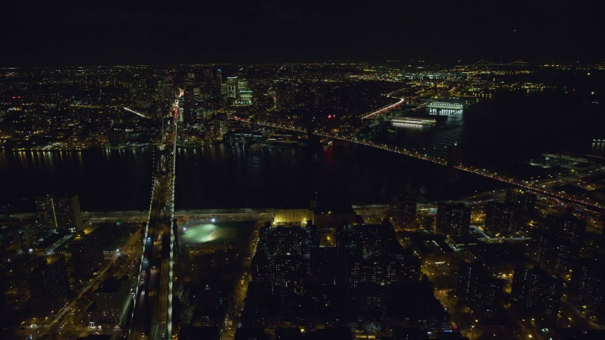 6K stock footage aerial video orbit Brooklyn and Manhattan Bridges over East River at Night, NYC Aerial Stock Footage | AX122_065