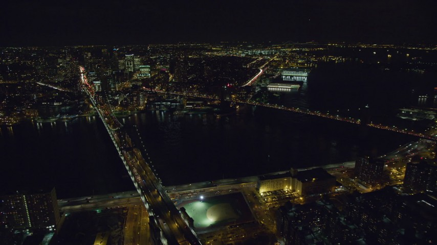 6K stock footage aerial video orbit the Brooklyn Bridge and Manhattan Bridge over East River at Night, NYC Aerial Stock Footage | AX122_066