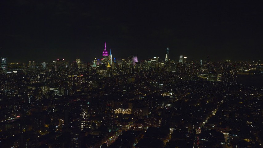 6K stock footage aerial video of Midtown skyscrapers seen from Lower East Side at Night in NYC Aerial Stock Footage | AX122_067