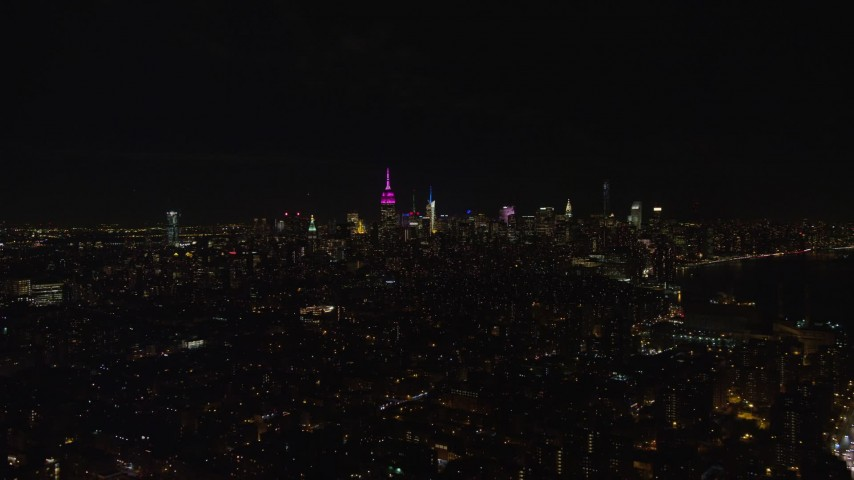 Orbit of Midtown Manhattan Skyscrapers at Night in NYC Aerial Stock Footage | AX122_069