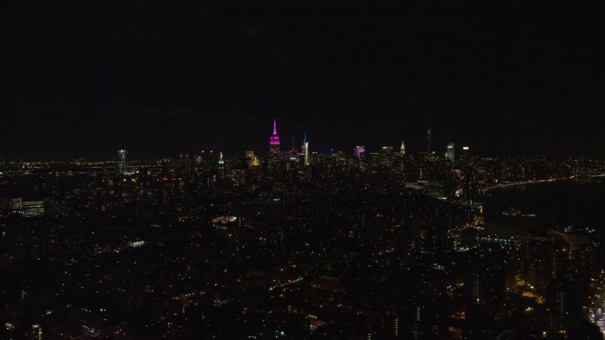 5.5K stock footage aerial video orbit of Midtown Manhattan skyscrapers at Night in NYC Aerial Stock Footage | AX122_069