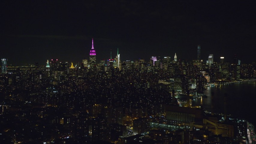 6K stock footage aerial video of Midtown Manhattan seen from the shore of the East River at Night, NYC Aerial Stock Footage | AX122_070