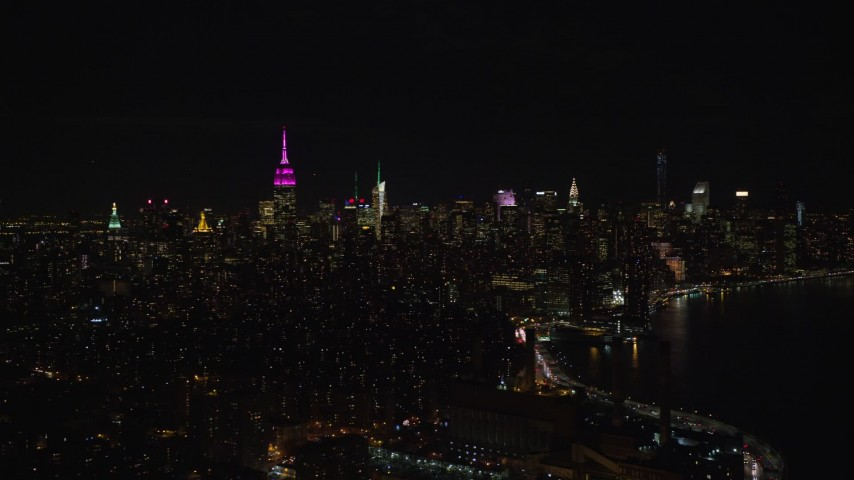 5.5K stock footage aerial video of Midtown Manhattan seen from the shore of the East River at Night, NYC Aerial Stock Footage | AX122_070E