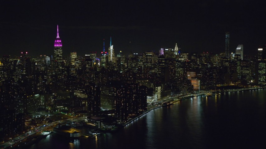 6K stock footage aerial video of skyscrapers in Midtown Manhattan at Night in NYC Aerial Stock Footage | AX122_074