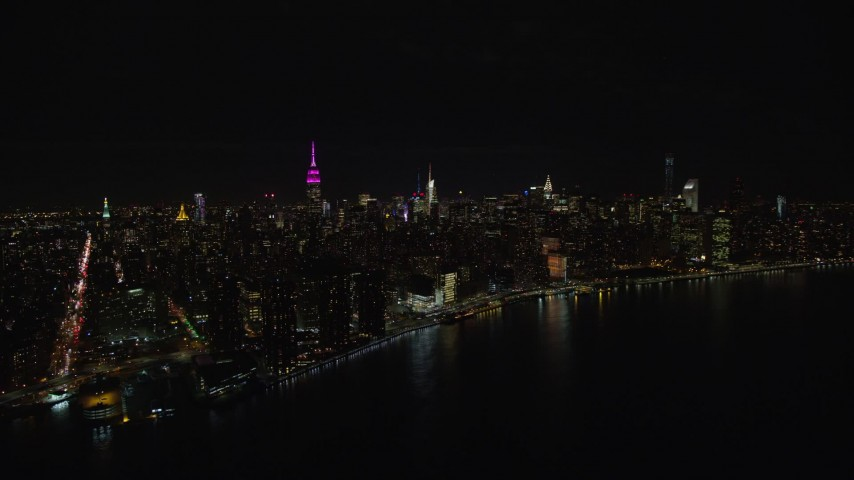 6K stock footage aerial video of Midtown Manhattan at Nighttime in New York City Aerial Stock Footage | AX122_075