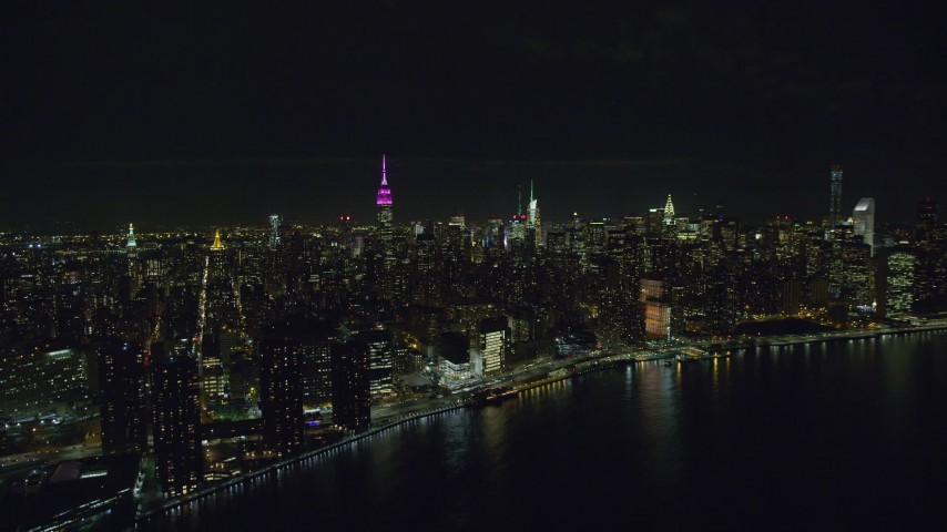 6K stock footage aerial video orbit Midtown Manhattan skyscrapers at Nighttime in NYC Aerial Stock Footage | AX122_076