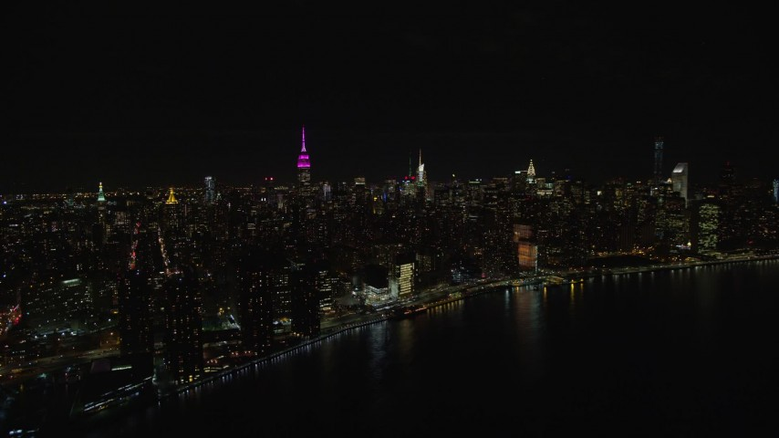 5.5K stock footage aerial video orbit Midtown Manhattan skyscrapers at Nighttime in NYC Aerial Stock Footage | AX122_076E